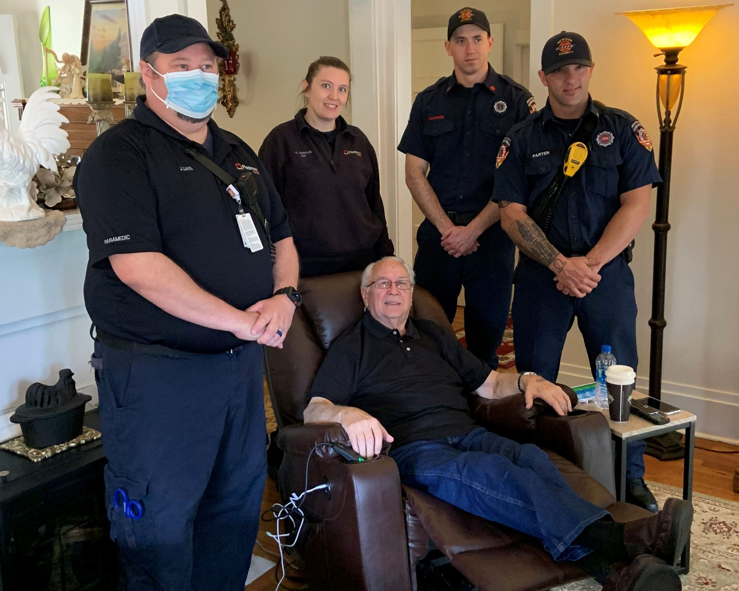 Image of Fire Services and EMT personnel with Jerry Patterson