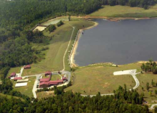 Aerial image of building on forested land